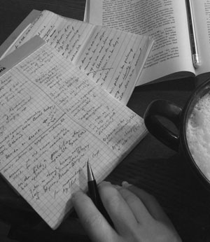 photo of desk with papers, book, coffee